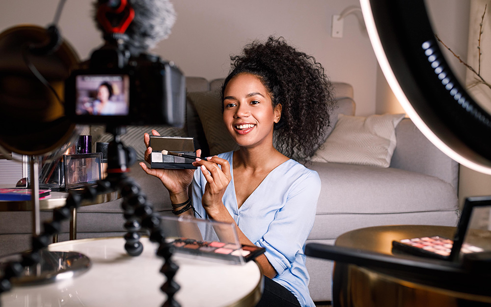 Smiling Woman Recording Her Video For Blog