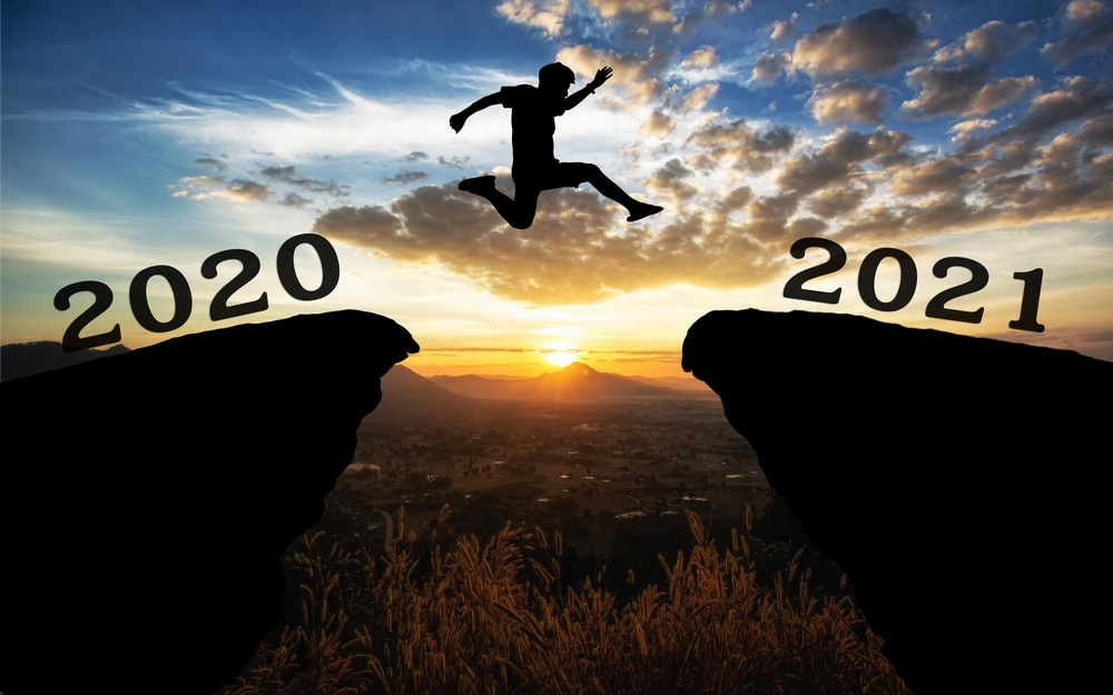 A young man jump between 2020 and 2021
