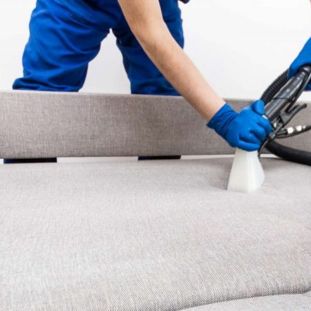 Man Vacuuming Couch